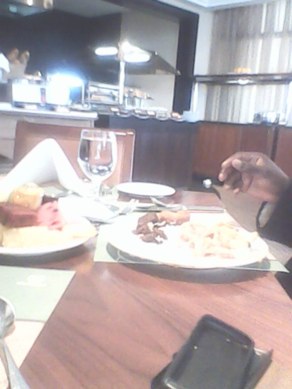 Kivumbi mom Queen Esther for lunch at Sheraton Hotel05